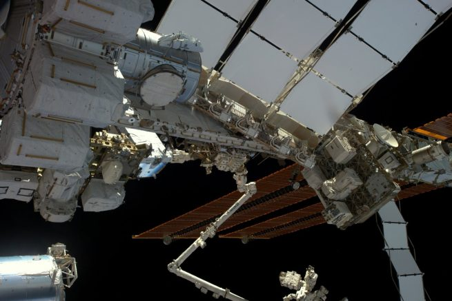 A view of the spacewalk work area for EVA-39 as seen from the Cupola window. The robotic Canadarm2 and Dextre can be seen in the center and bottom of the photo. Photo Credit: NASA