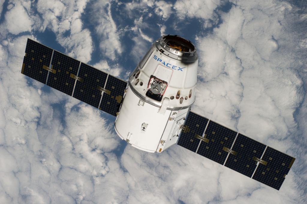 A file photo of a previous Dragon rendezvous. Photo Credit: NASA