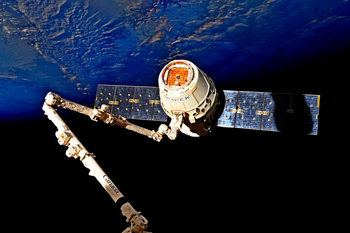 The CRS-11 Dragon capsule is positioned for release beneath the ISS. Photo Credit: Jack Fischer / NASA Read more at http://www.spaceflightinsider.com/missions/iss/dragon-splashes-down-in-pacific-with-time-critical-experiments/#4VmKj1SmWVM3hxYR.99