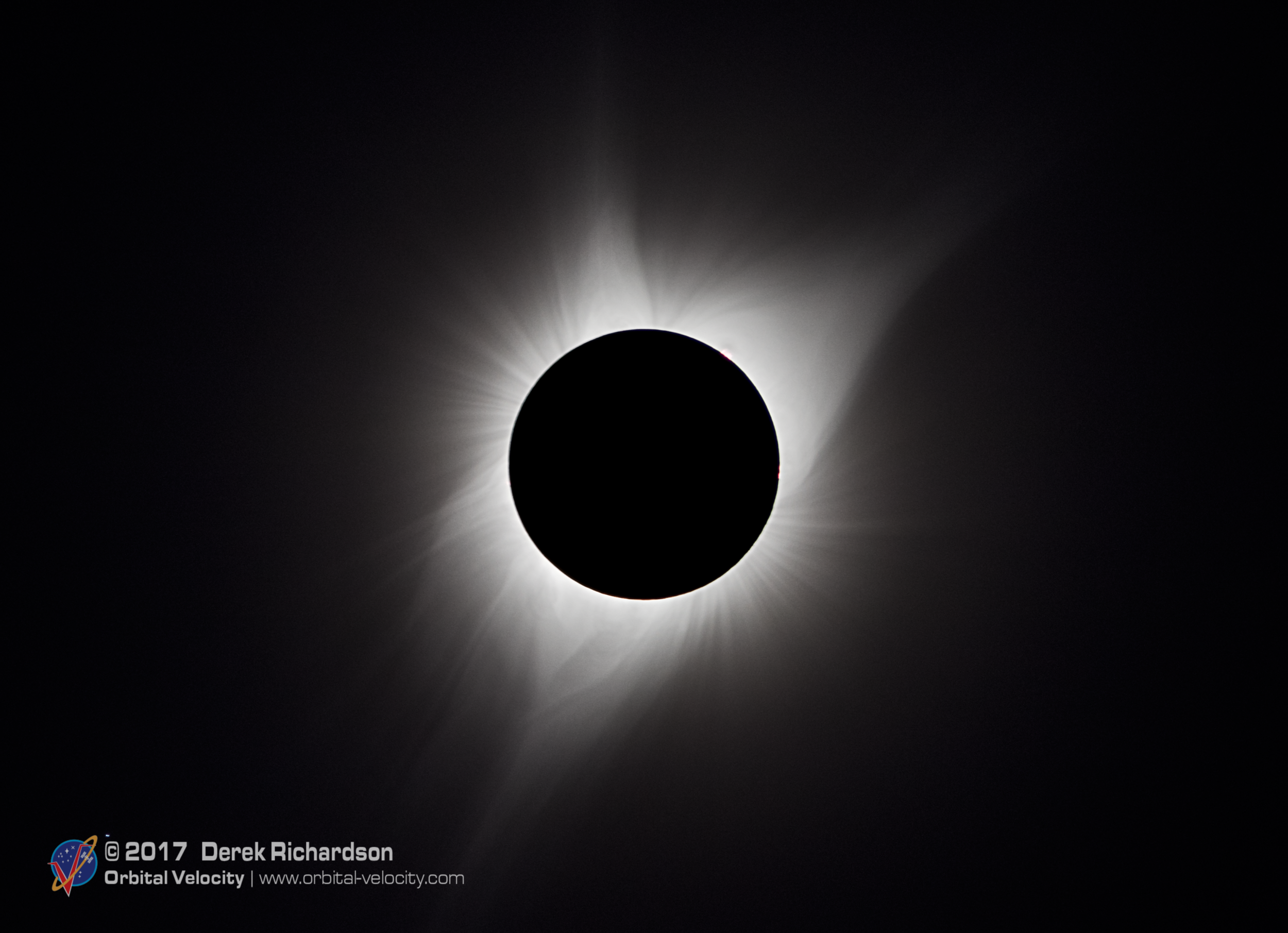 A composite of several exposures of totality. While human eyes can see a wide range of details, it is difficult for one image to capture the full scope of the eclipse. In reality, it often requires multiple exposures stacked on top of each other. Photo Credit: Derek Richardson / Orbital Velocity