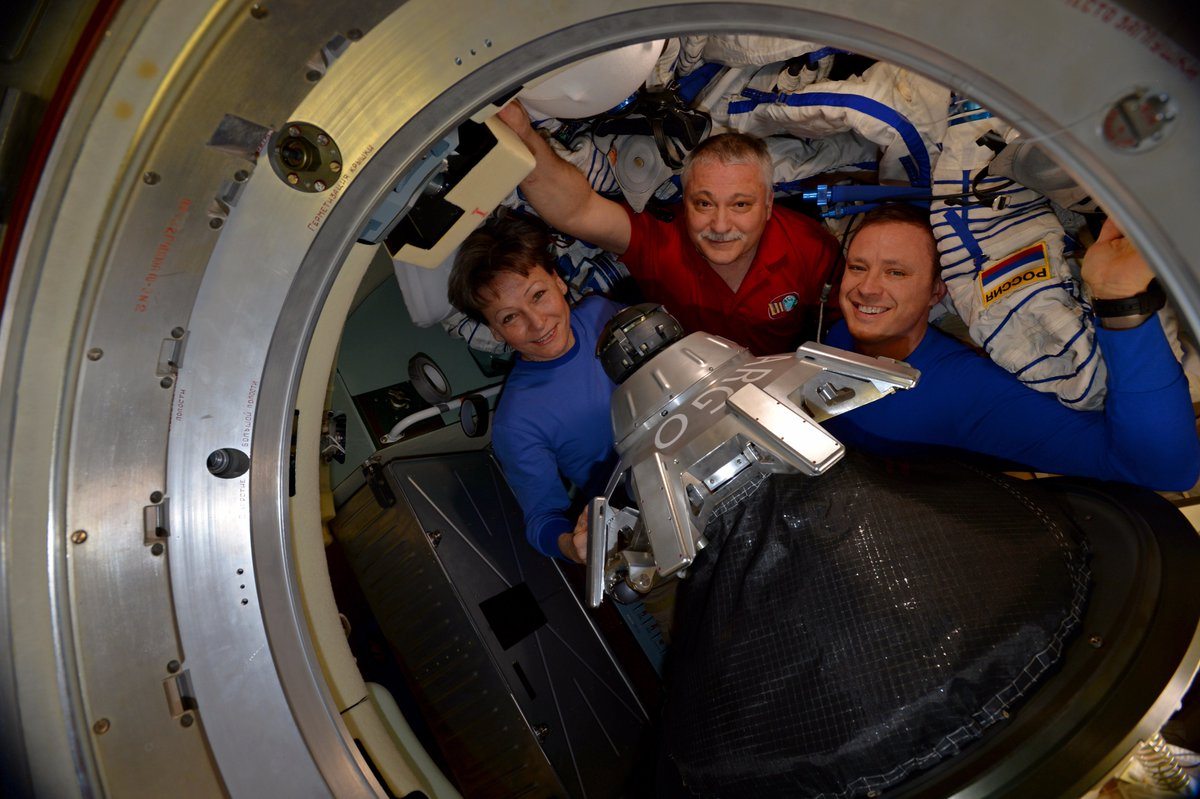 Peggy Whitson, left, Fyodor Yurchinkhin, center, and Jack Fischer pose for one last photo before hatch closure. Photo Credit: NASA