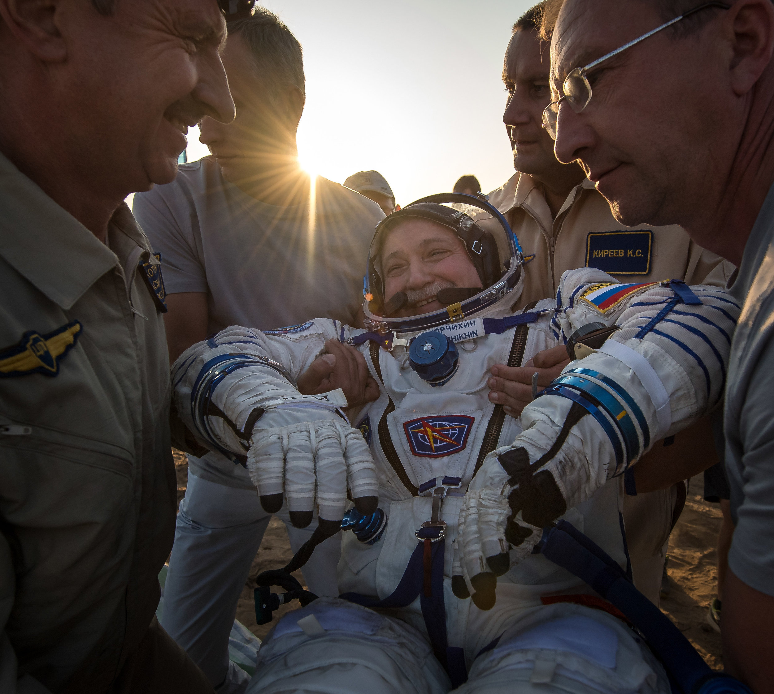 Fyodor Yurchikhin is the first to be helped out of the Soyuz MS-04 spacecraft just minutes after he and NASA astronauts Peggy Whitson, and Jack Fischer landed. Photo and Caption Credit: Bill Ingalls / NASA
