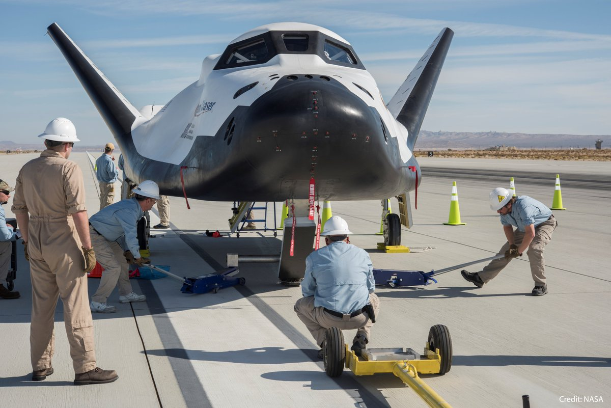 Engineers work to safe Dream Chaser after a successful runway landing at Edwards Air Force Base in California. Photo Credit: NASA