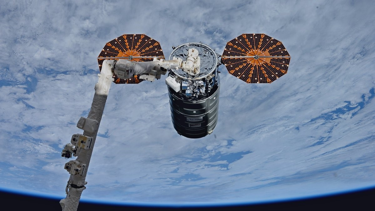 The OA-8 Cygnus, named  S.S. Gene Cernan , is captured by the International Space Station's robotic  Canadarm2 . Photo Credit: NASA