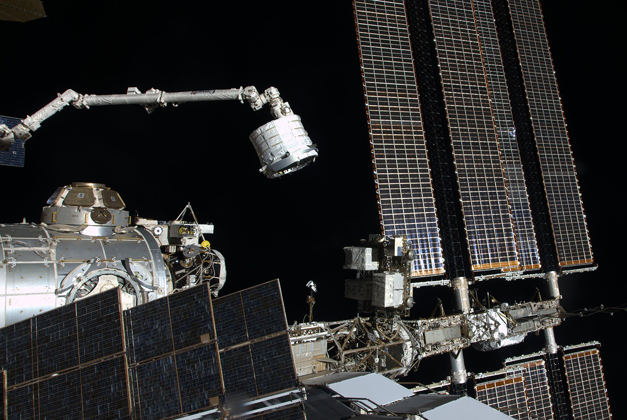 Canadarm2 is used for a variety of functions on the space station, including moving modules and hardware around the outpost. In this photo, the arm is moving the pre-expanded Bigelow Expandable Activity Module from the trunk of a Dragon spacecraft to its final location on the aft-end of the Tranquility module in April 2016. Credit: NASA