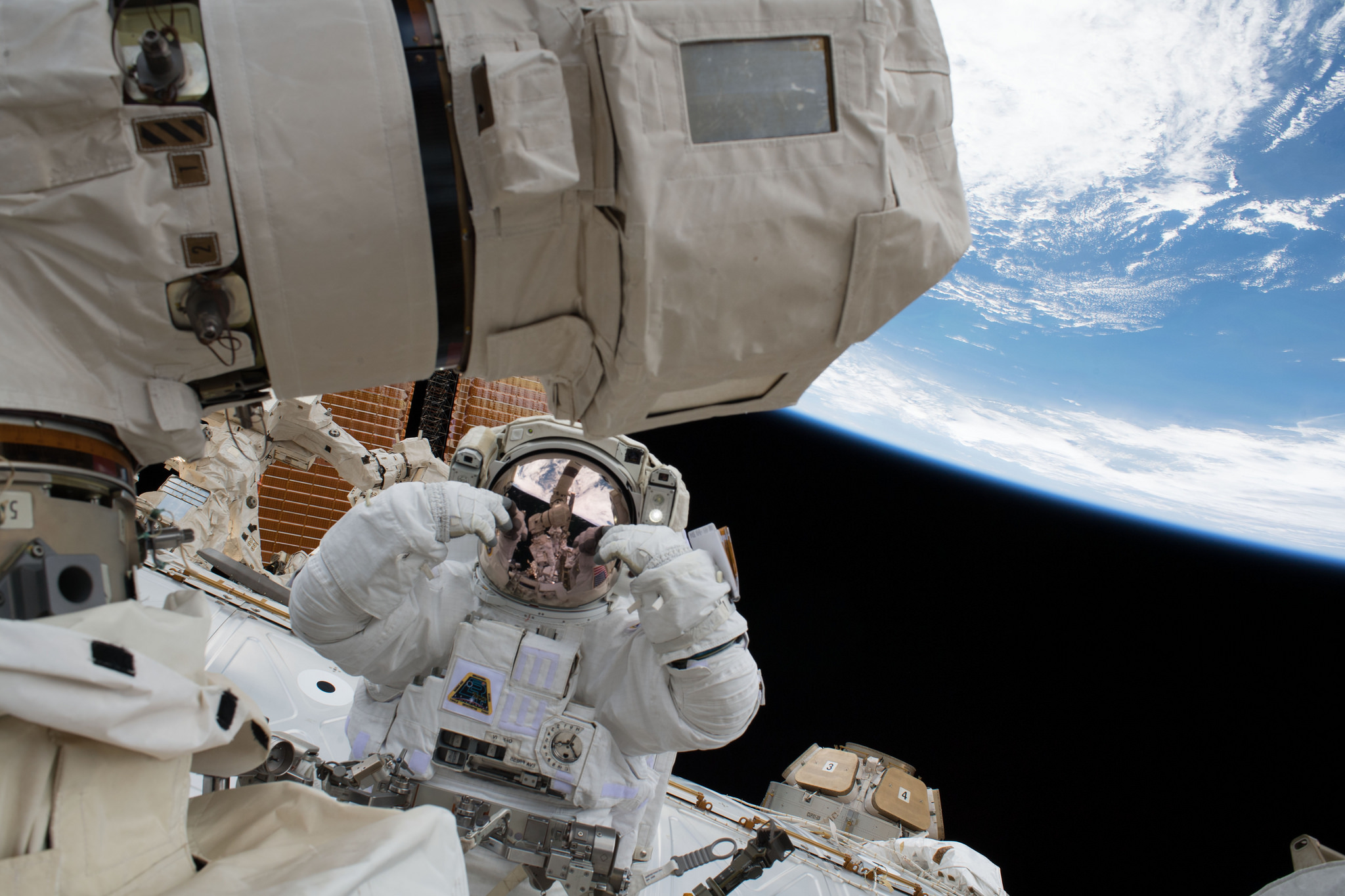 Scott Tingle, along with Mark Vande Hei, not pictured, work to swap out the old LEE-B during U.S. EVA-47. Credit: NASA