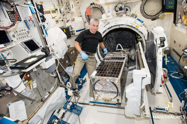 NASA astronaut Mark Vande Hei with the Kestrel Eye IIM brought to the ISS in 2017 by NanoRacks on a commercial Dragon spacecraft. It was deployed from the ISS via the company's Kaber Microsat Deployer. Credit: NanoRacks