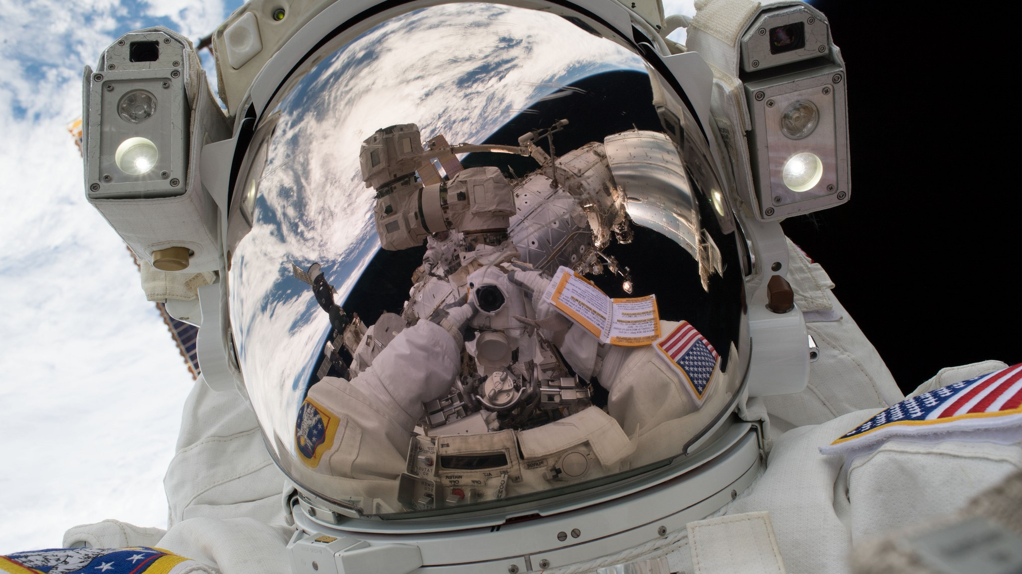 """NASA astronaut Mark Vande Hei takes a """"space-selfie"""" during U.S. EVA-47, the first spacewalk of 2018. He once again ventured outside, this time with Japanese astronaut Norishige Kanai, for U.S. EVA-48, which completed work upgrading the robotic Canadarm2. Credit: Mark Vande Hei / NASA"""