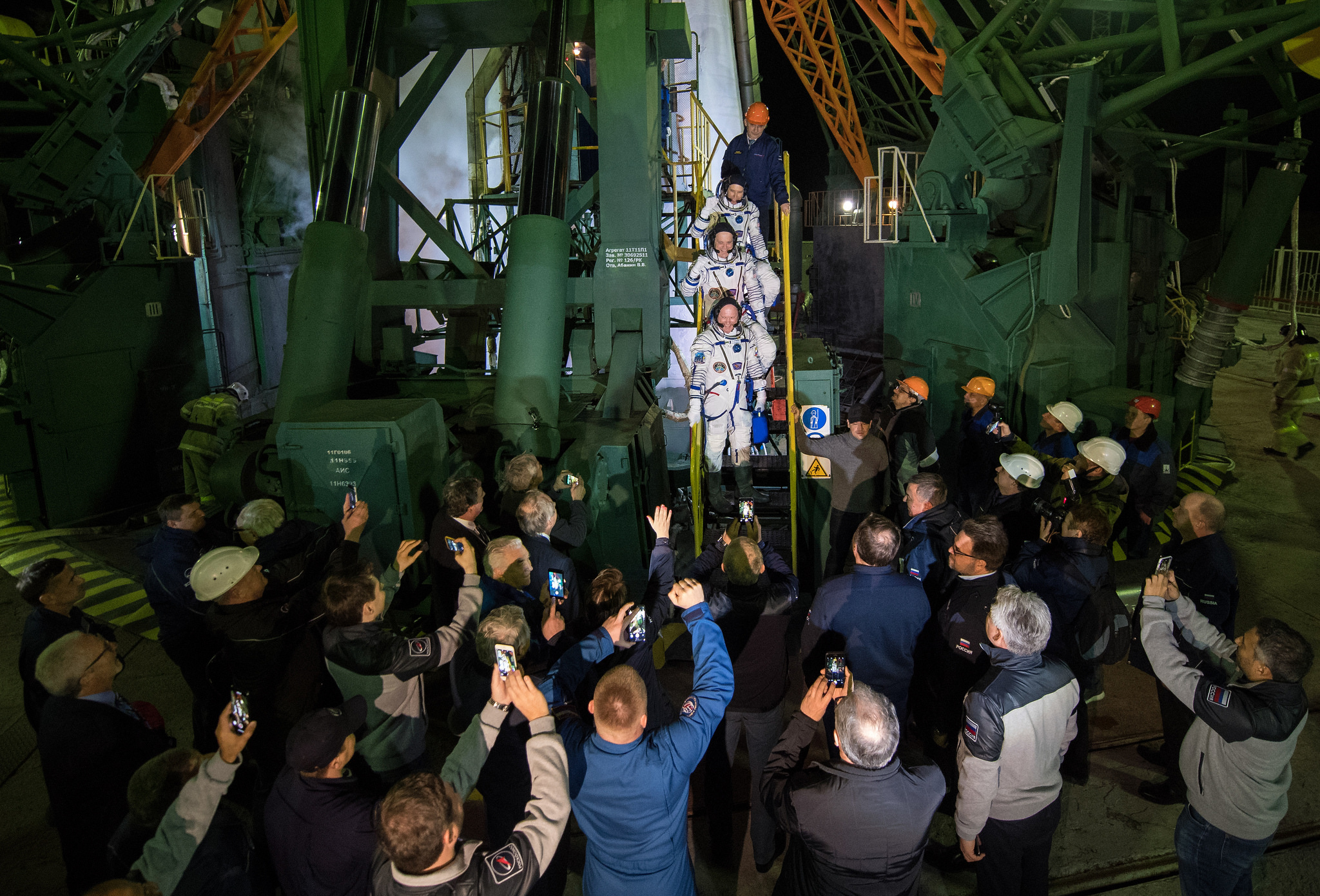 The crew says one more farewell before boarding their Soyuz MS-08 spacecraft. Credit: NASA/Joel Kowsky