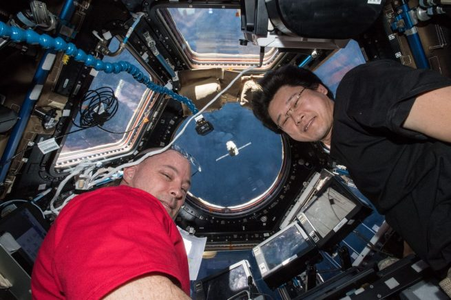 NASA astronaut Scott Tingle and Japan Aerospace Exploration Agency astronaut Norishige Kanai monitor Dragon as it rendezvoused with the outpost in early April 2018. Credit: NASA