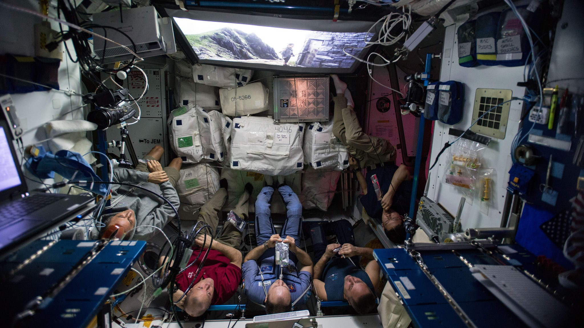 """The Expedition 54 crew watch a special screening of """"Star Wars: The Last Jedi""""in the station's Harmony module. Credit: NASA"""