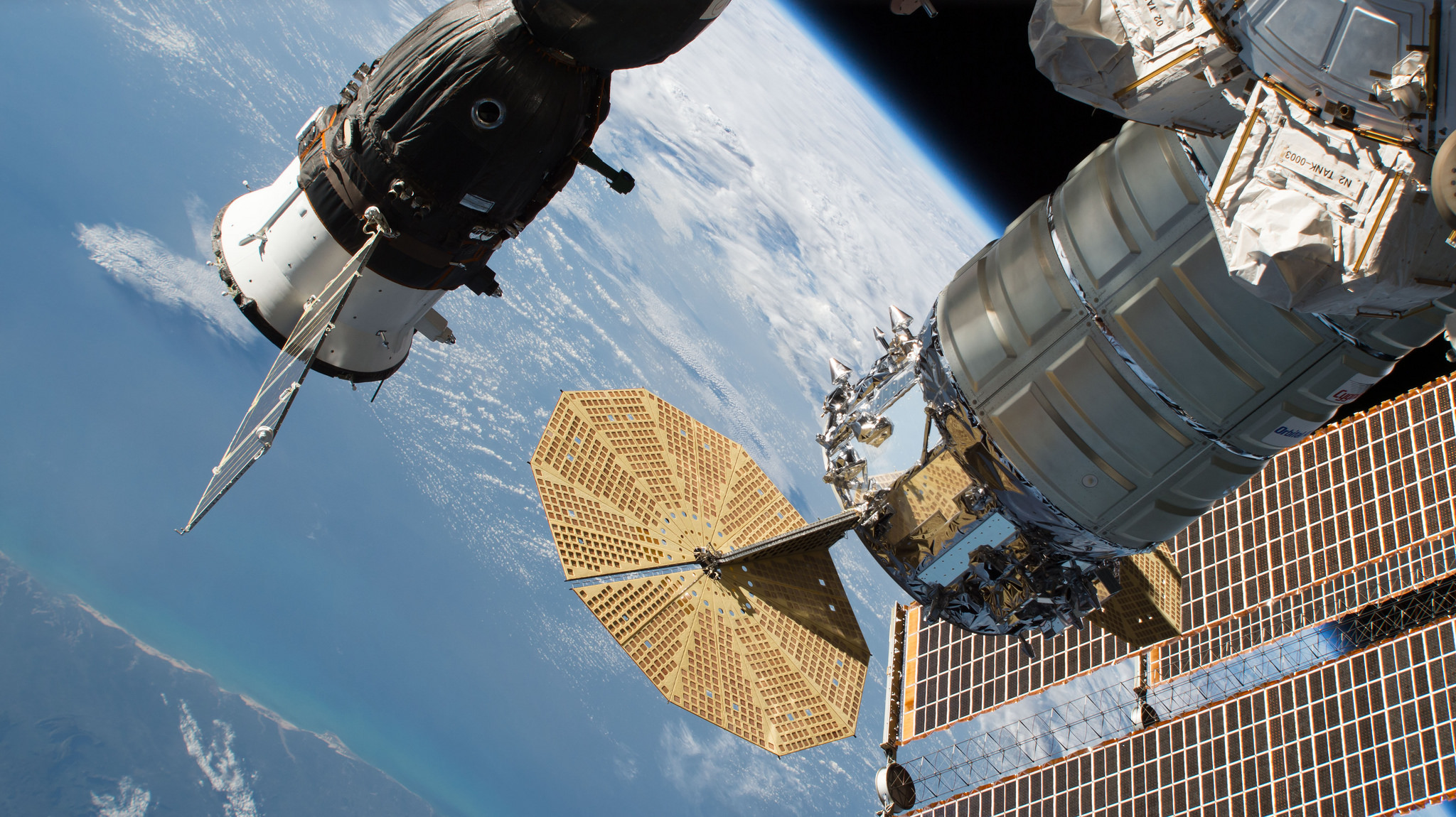 A view of the OA-9 Cygnus with Soyuz MS-09 docked in the background. Credit: NASA