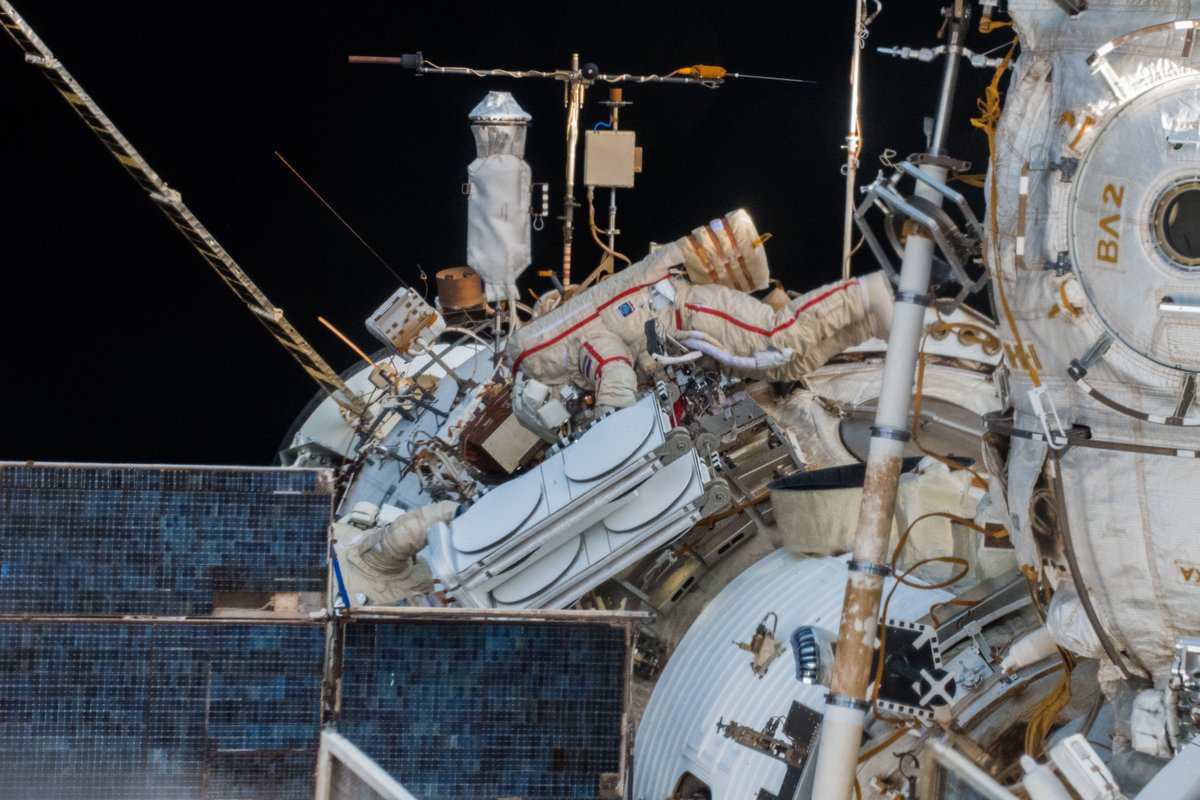 The two cosmonauts install the Icarus antenna on its boom on Zvezda. Credit: Alexander Gerst / ESA