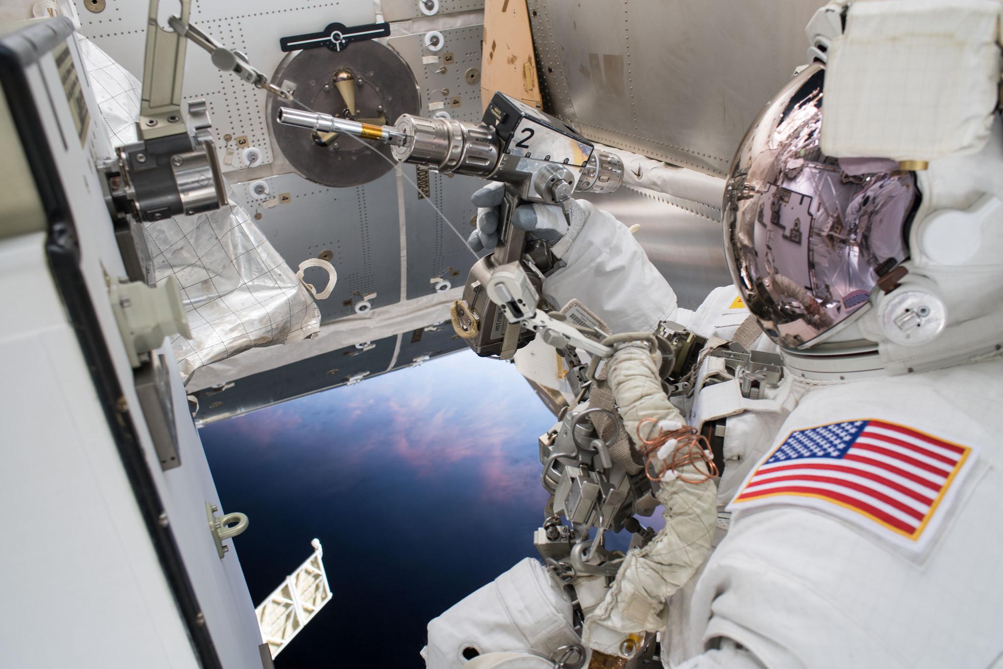 NASA astronaut Drew Feustel works to swap thermal control gear during U.S. EVA-50. Credit: NASA