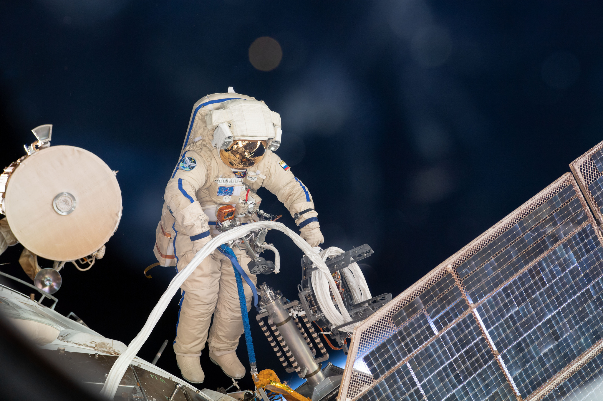 Russian cosmonaut Sergey Prokopyev lays cable for the installation of the Icarus experiment. Credit: NASA