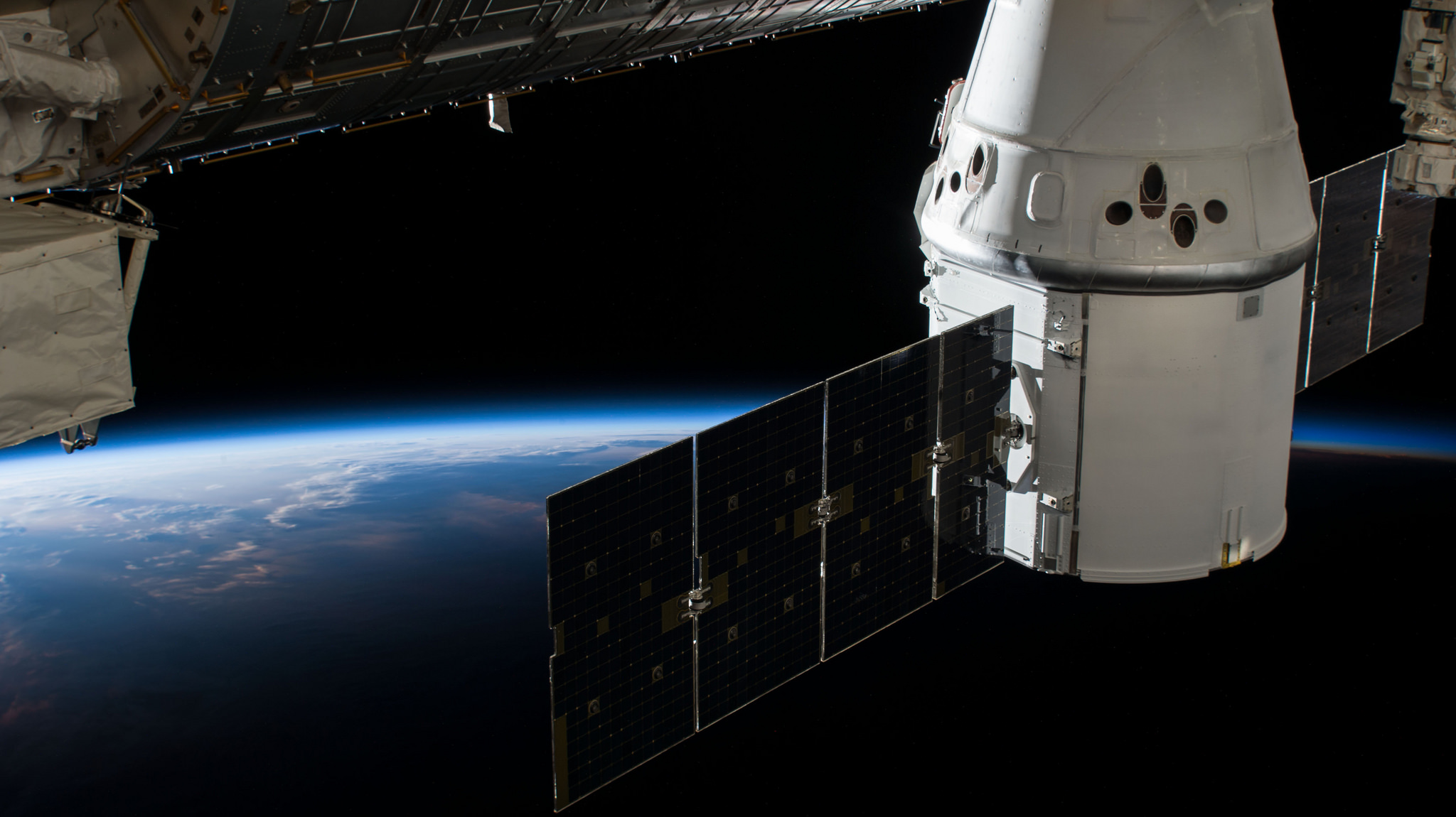 The CRS-15 Dragon attached to the ISS before being unberthed. Credit: NASA