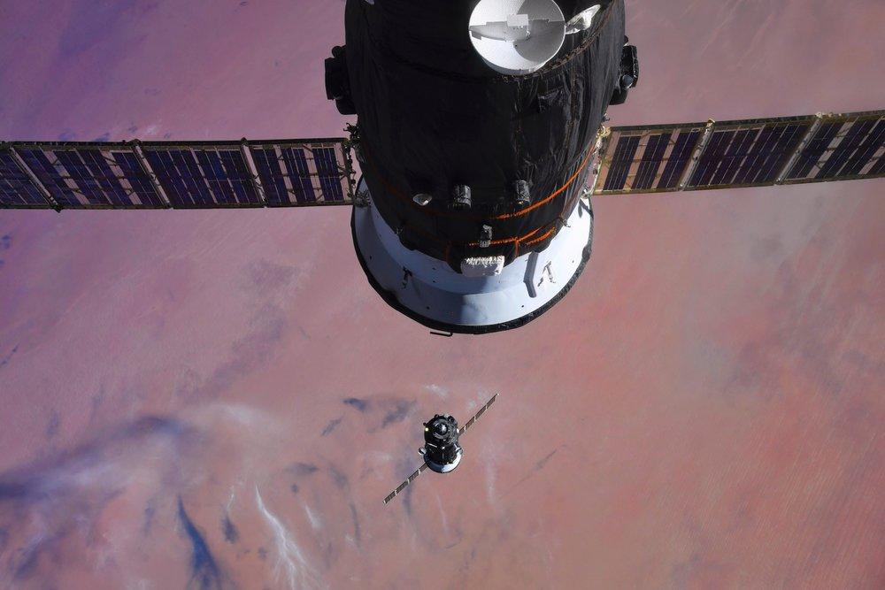 Soyuz MS-07, bottom, approaches the International Space Station. Credit: Roscosmos