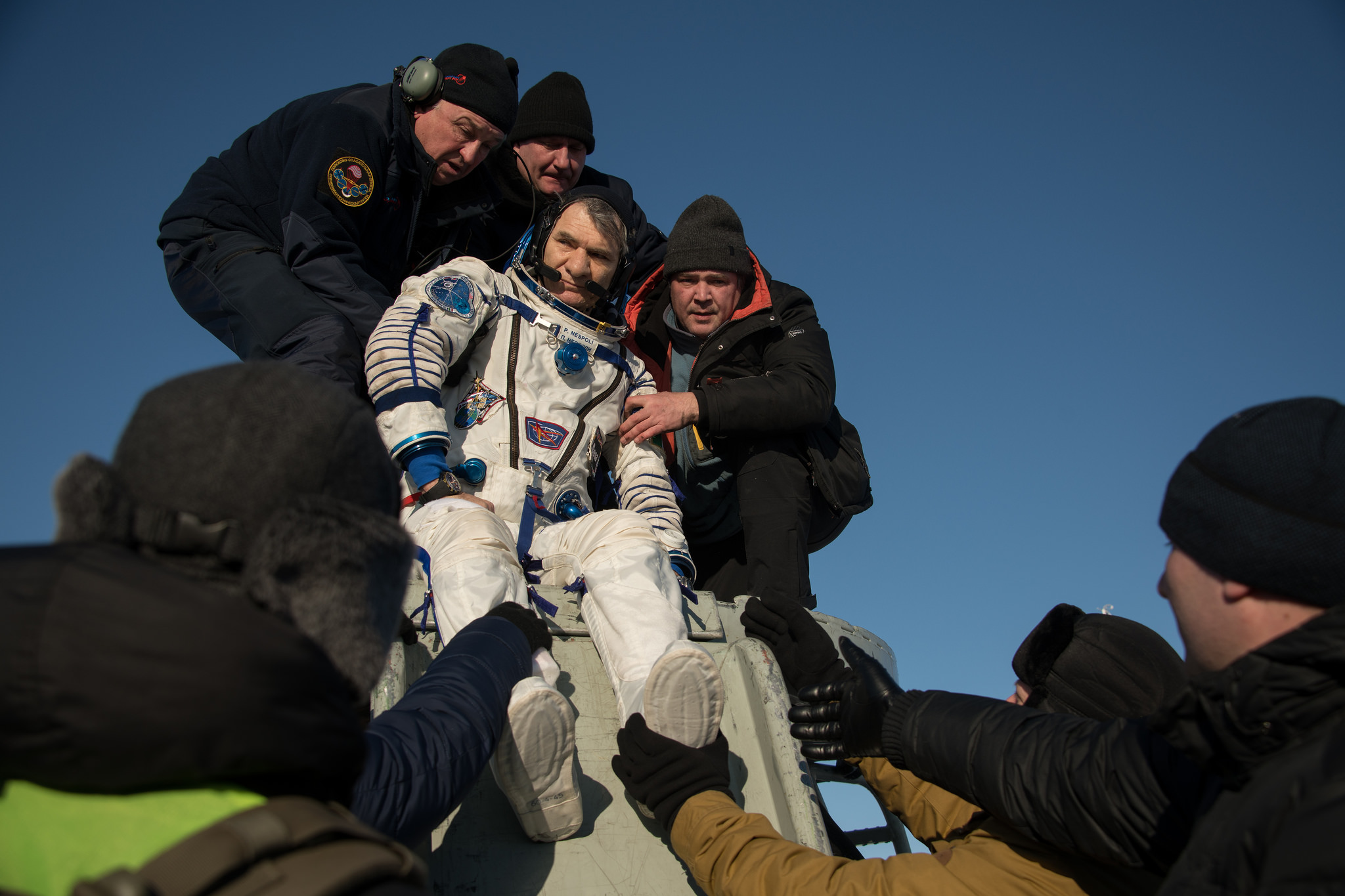 Paolo Nespoli is helped out of Soyuz MS-05. Credit: NASA/Bill Ingalls