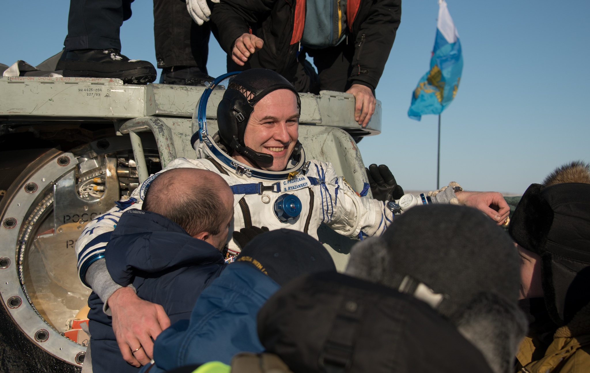Sergey Ryazansky is helped out of the Soyuz MS-05 spacecraft. Credit: NASA/Bill Ingalls