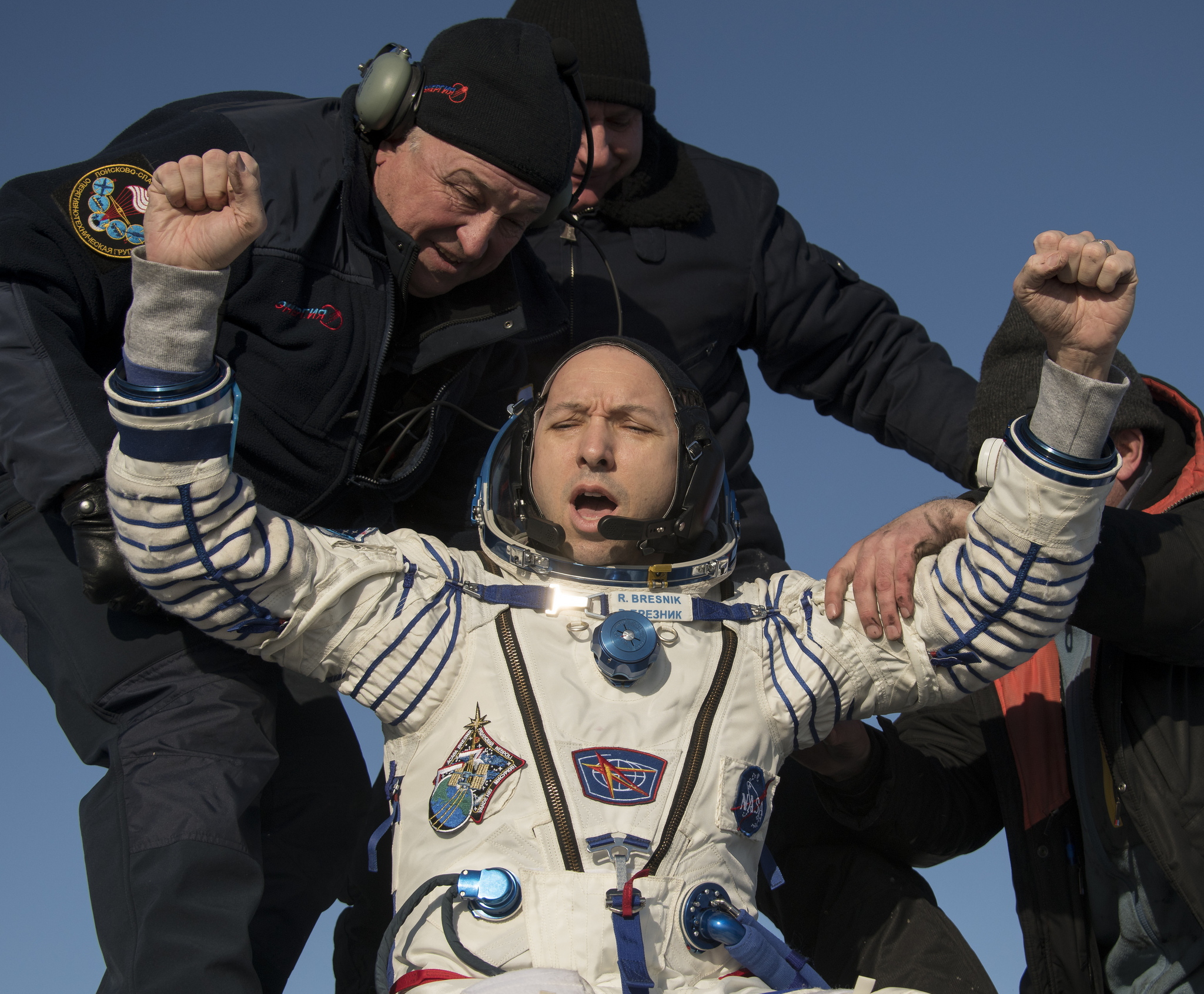 Randy Bresnik is helped out of Soyuz MS-05. Credit: NASA/Bill Ingalls