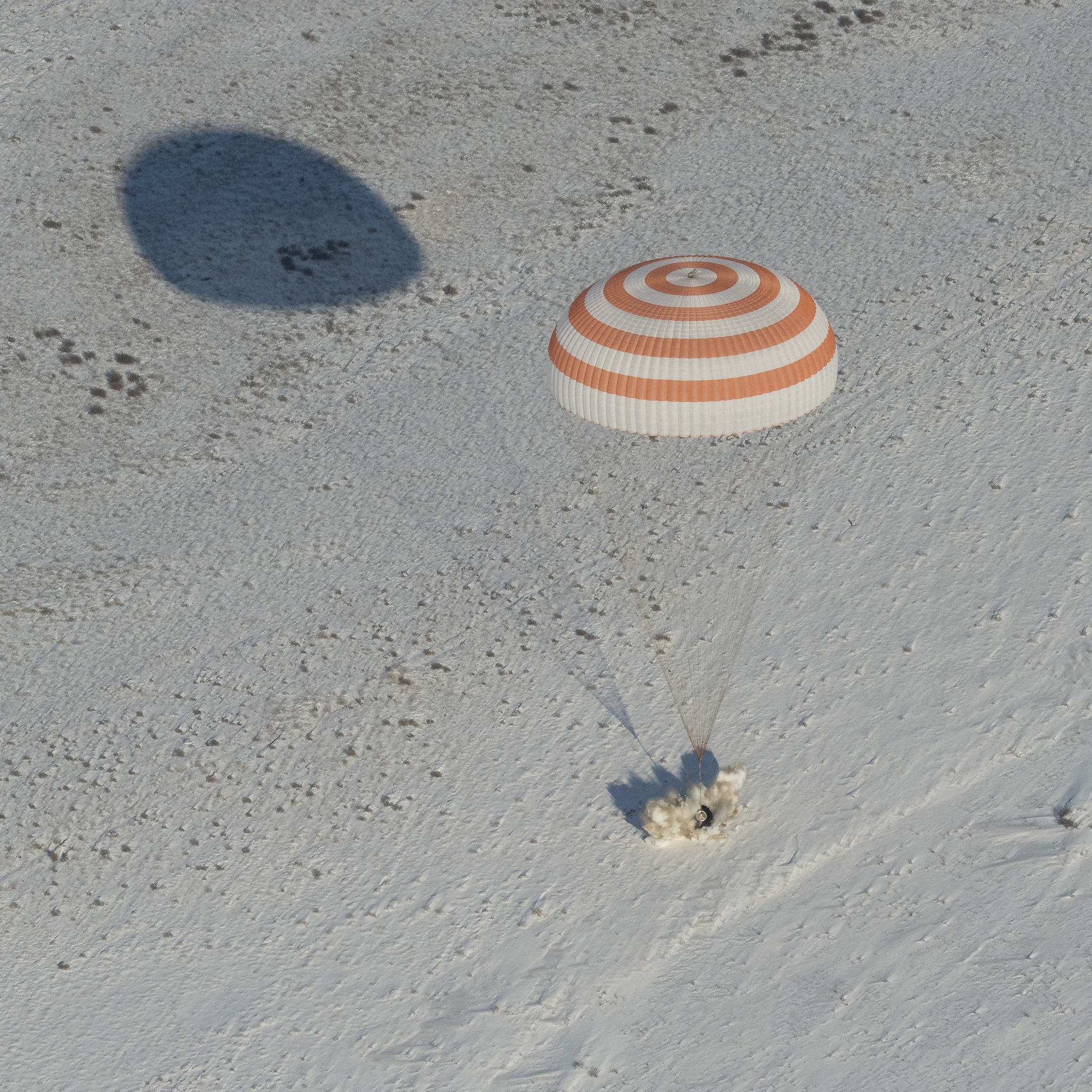 The Soyuz MS-05 capsule fires its landing jets to cushion the impact of touchdown. Credit: NASA/Bill Ingalls