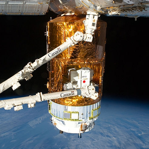 The station's robotic arm removes the Exposed Pallet from the Kounotori's Unpressurized Logistics Module. Credit: NASA
