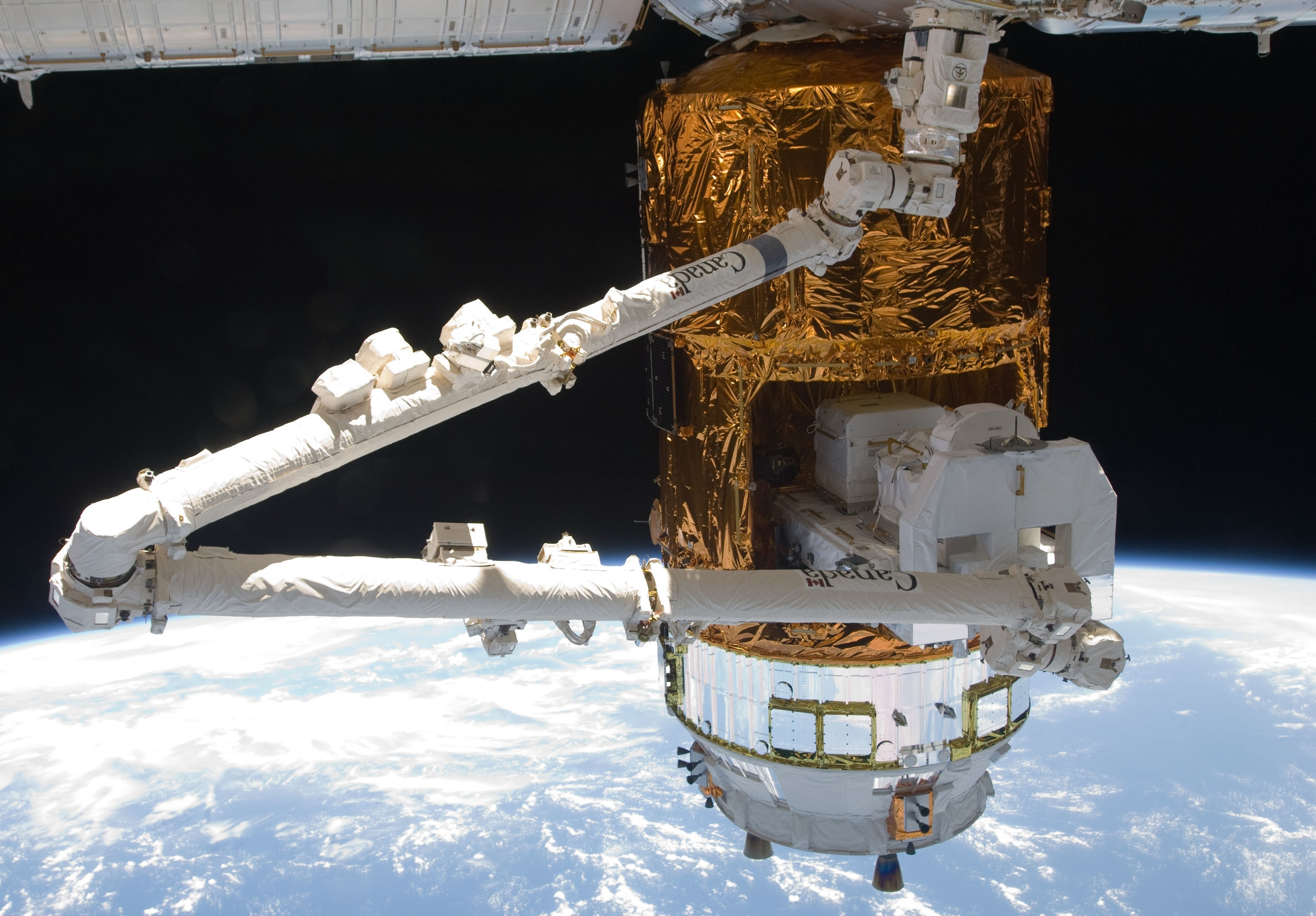 Equipment is removed from the Unpressurized Logistics Module by the robotic Canadarm2. Credit: NASA