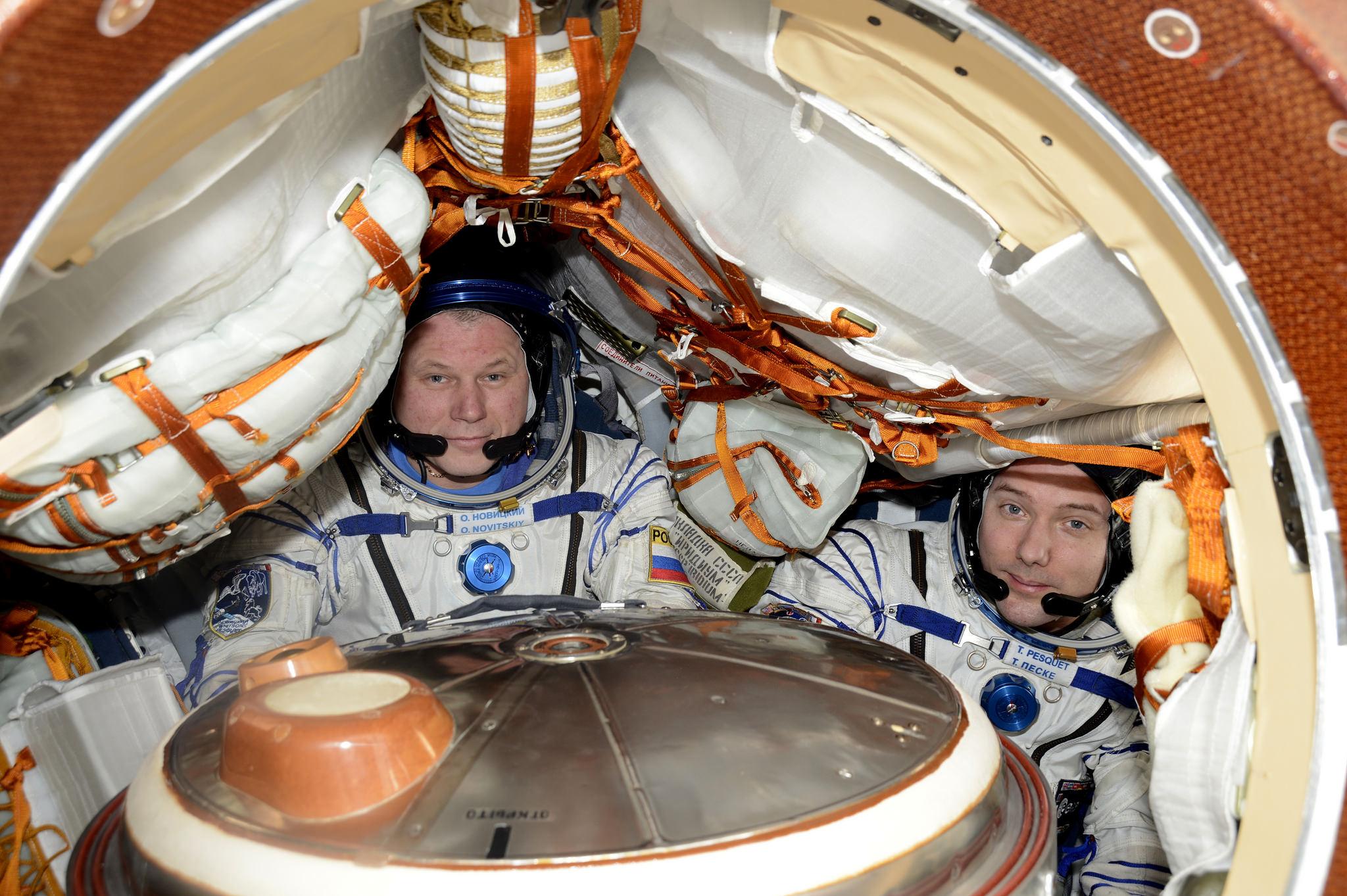 Oleg Novitskiy of Russia and Thomas Pesquet of the European Space Agency inside their Soyuz MS-03 spacecraft. Credit: NASA