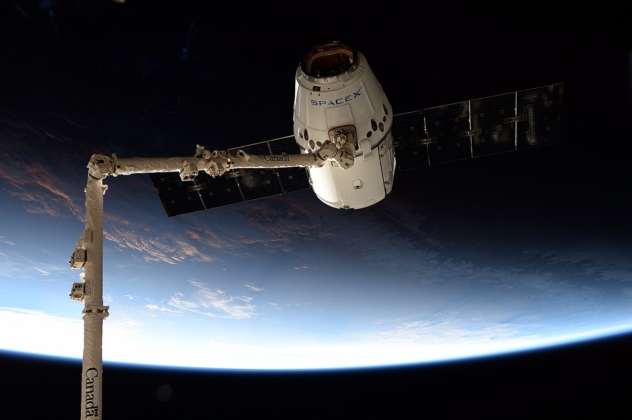 The CRS-12 Dragon is captured just before an orbital sunrise. Credit: NASA