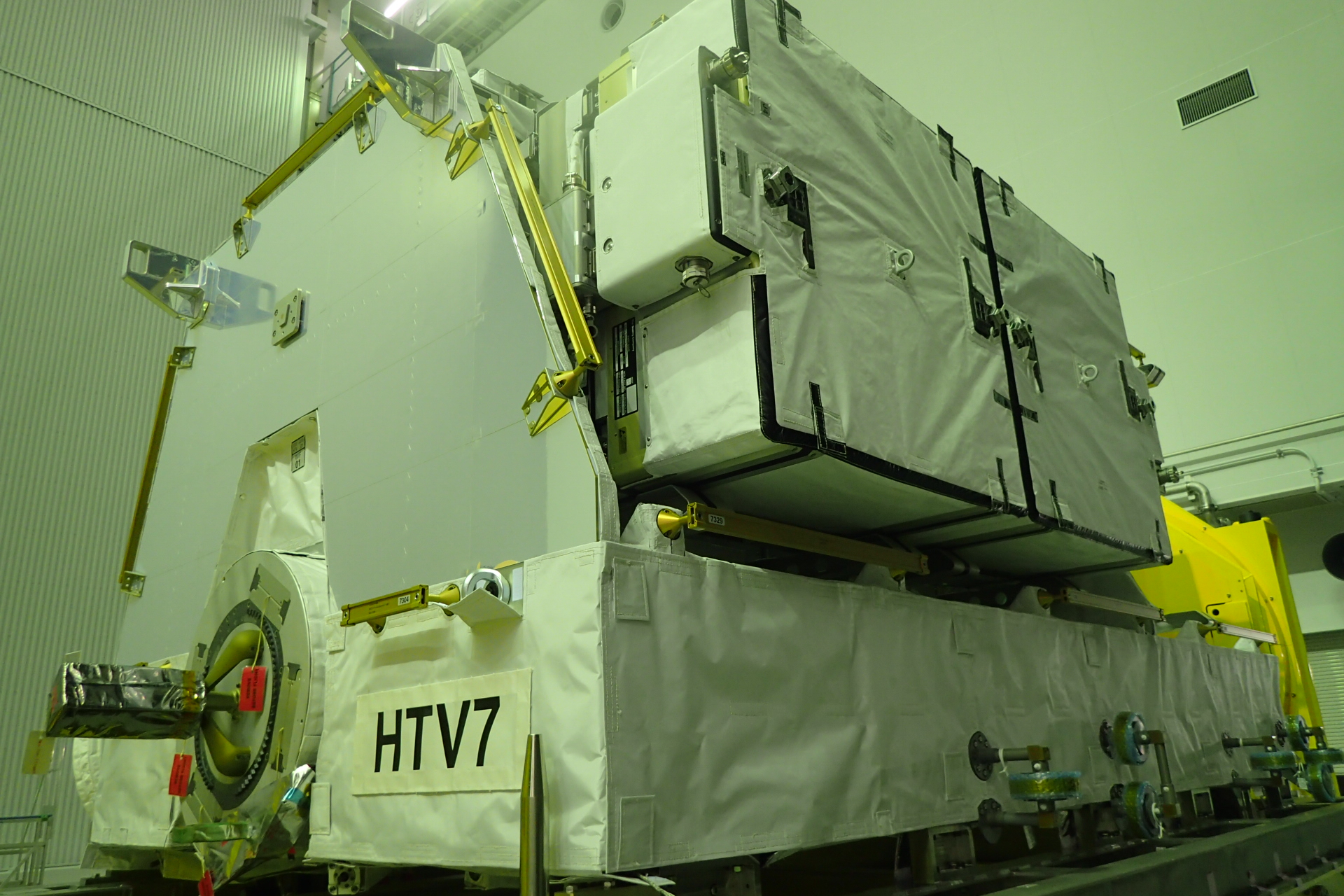 The lithium-ion batteries loaded on an exposed pallet that will be placed inside the Unpressurized Logistic Carrier. Two of the batteries, right, can be seen. A total of six fit on the platform. Credit: JAXA