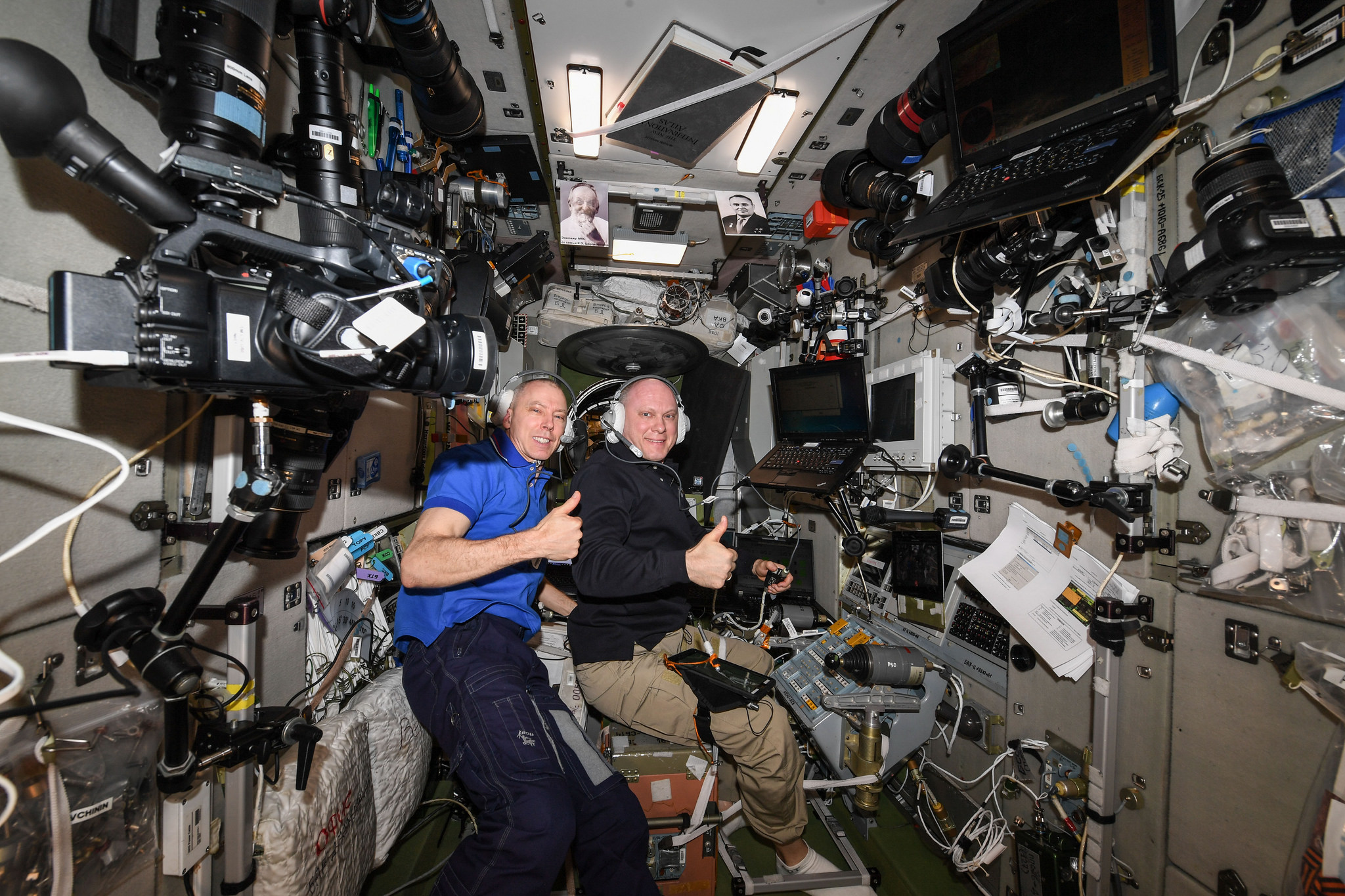 Expedition 56 Commander and NASA astronaut Drew Feustel, left, and Russian cosmonaut Oleg Artemyev of Roscosmos inside the Zvezda service module practicing Soyuz descent procedures several days before landing. Credit: NASA