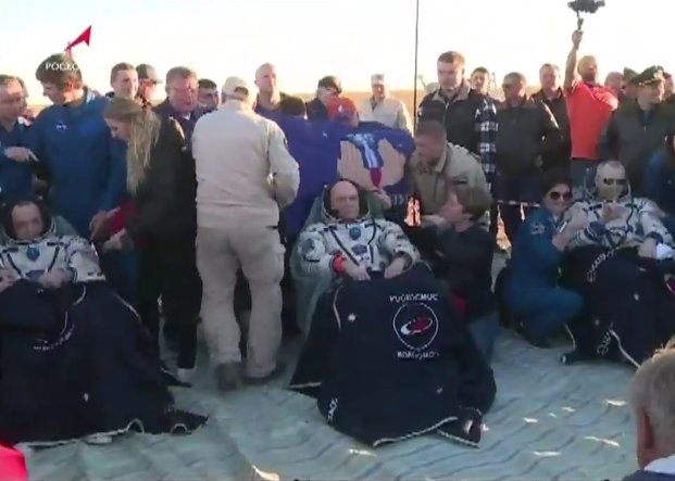 The Soyuz MS-08 crew sits in their reclining chairs after being extracted by Russian recovery teams. Credit: NASA TV