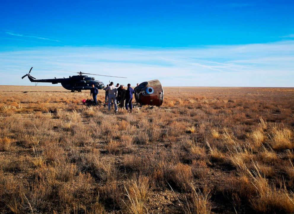 Search and rescue teams meet with Aleksey Ovchinin and Nick Hague in their capsule right as they land. Landing took place about 30 minutes after launch. Credit: Russian Defense Ministry Press Service