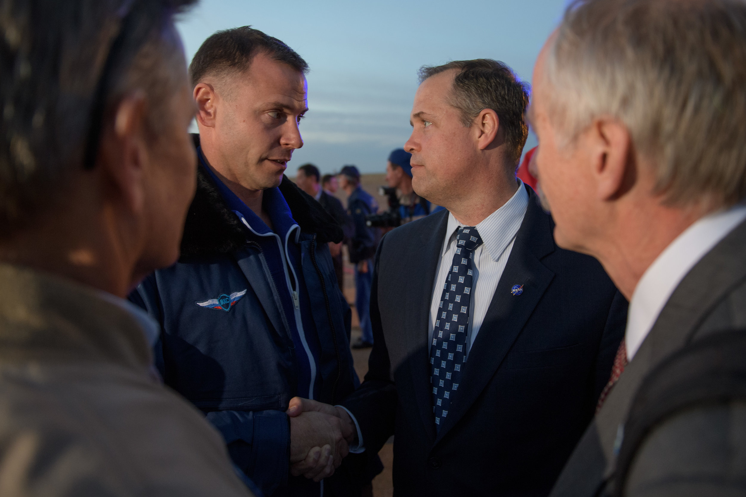 NASA Administrator Jim Bridenstine shakes Nick Hague's hand after being recovered following the Soyuz MS-10 in-flight launch abort. Credit: NASA/Bill Ingalls