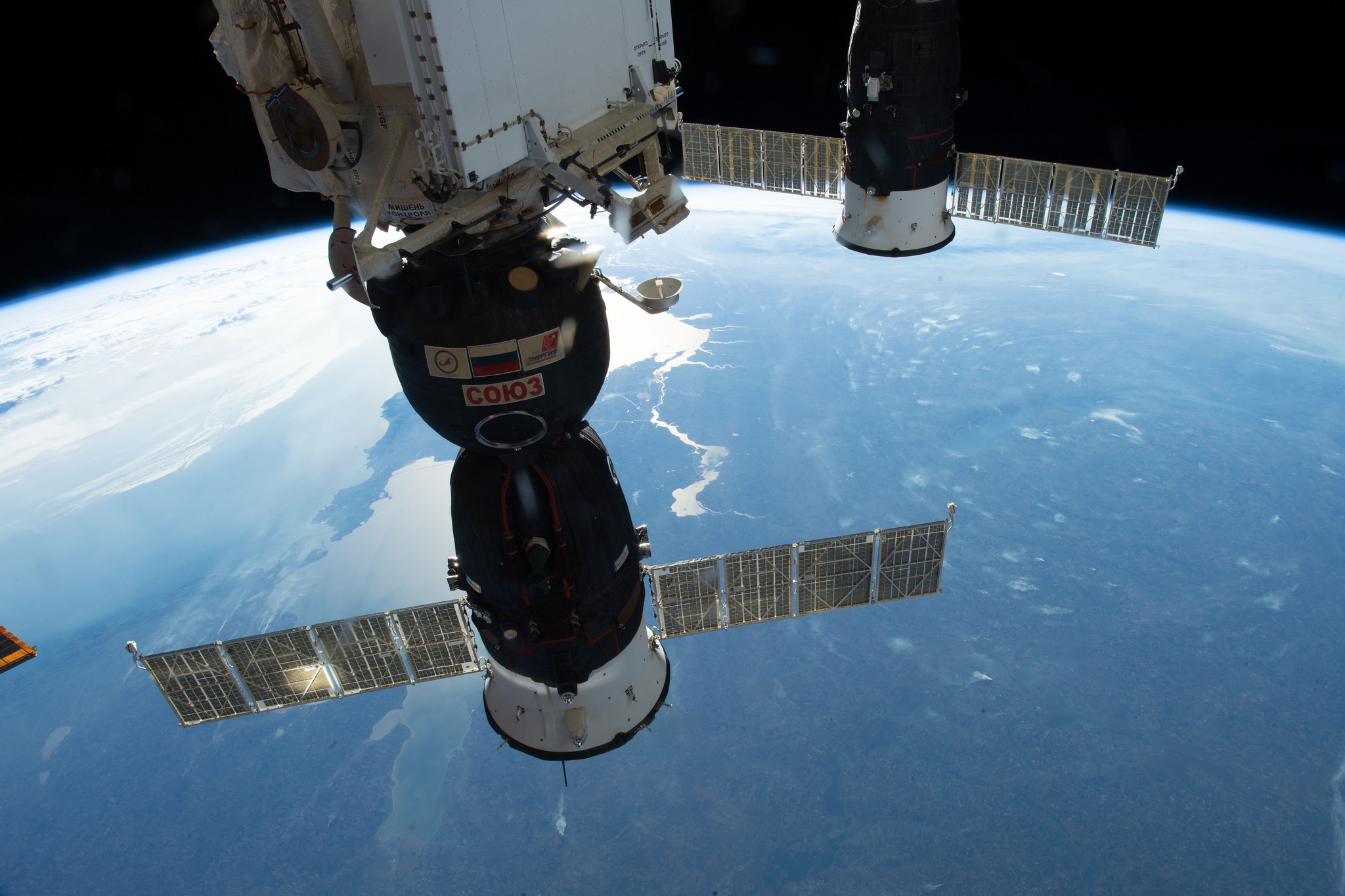 Soyuz MS-09, front, and Progress MS-09 are pictured docked to the International Space Station on Oct. 13. Credit: NASA