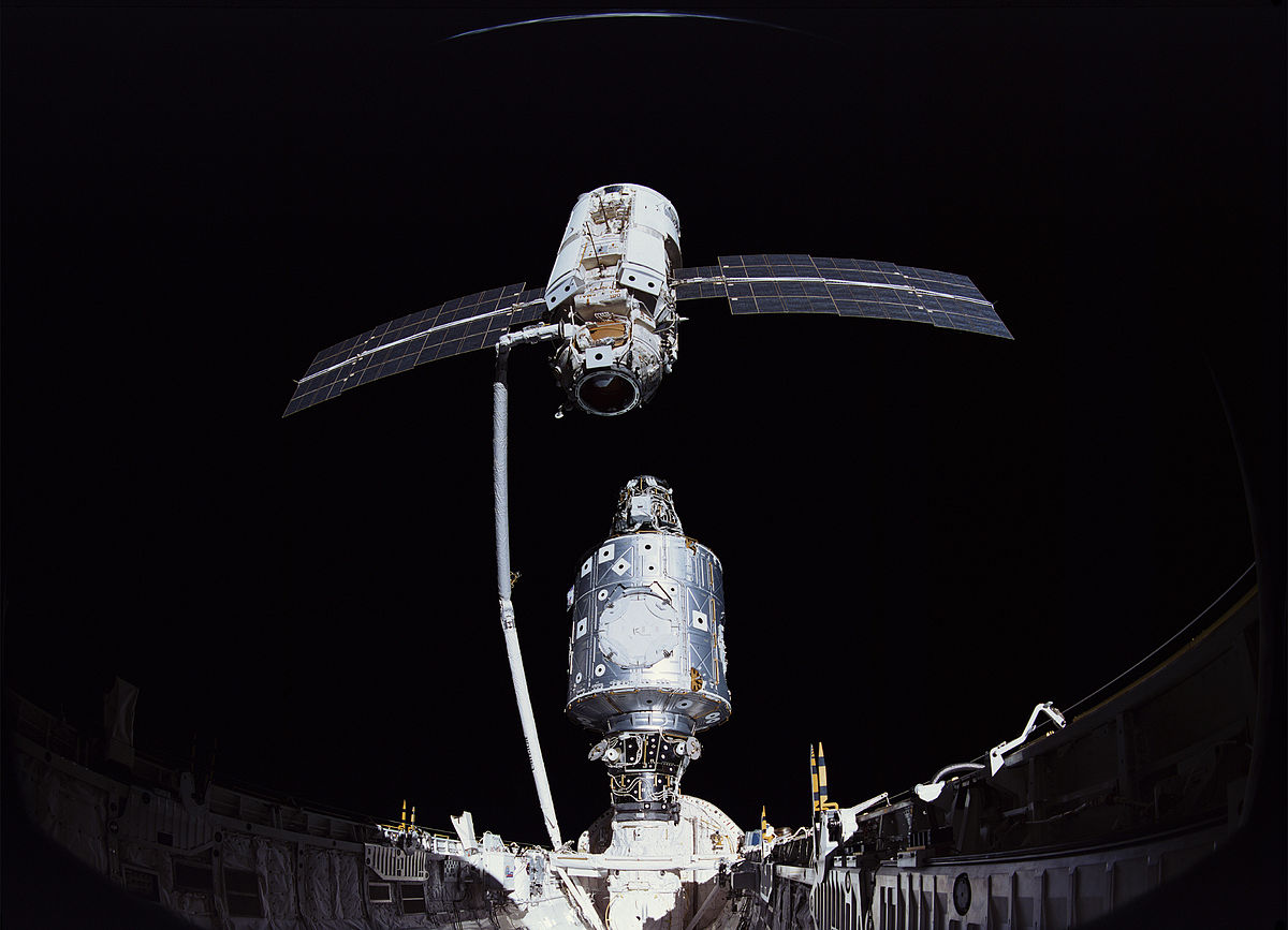Using Endeavour's robotic arm, Zarya is captured and moved into position to attach to the Unity module. Credit: NASA
