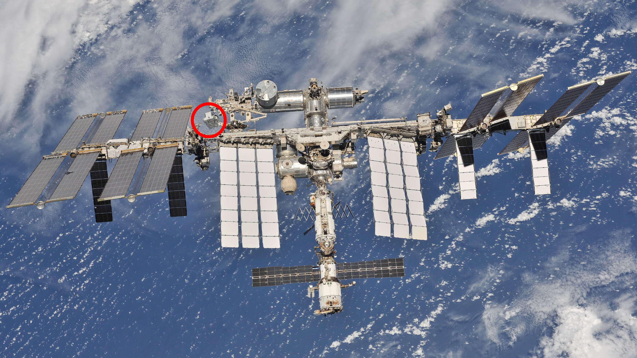 The location of the Exposed Pallet (seen in the red circle) as of the departure of Soyuz MS-08 on Oct. 4, 2018. Click for larger view. Credit: NASA/Roscosmos