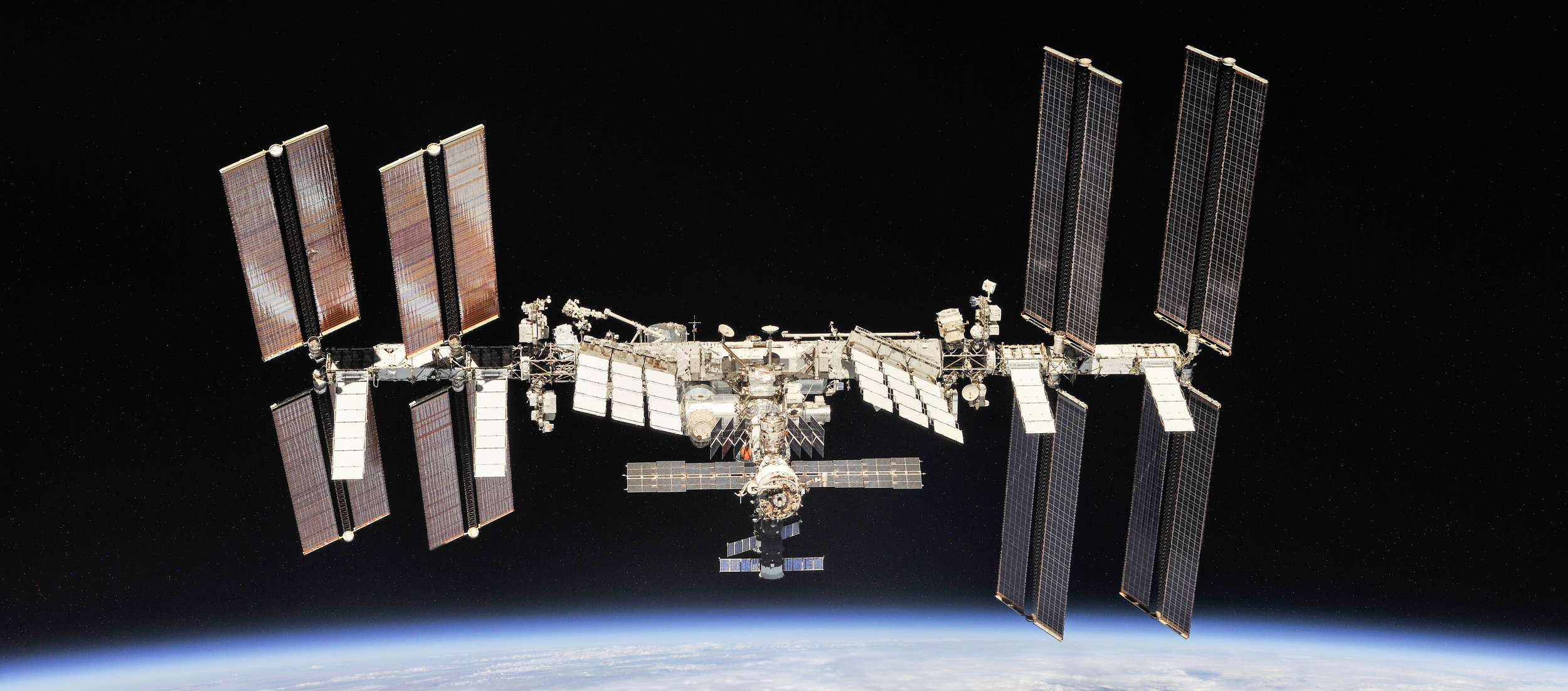 The International Space Station as seen following the departure of the Soyuz MS-08 spacecraft on Oct. 4, 2018. Progress MS-10 is expected to dock at the aft port of the Zvezda module at the rear of the space station. Credit: NASA/Roscosmos