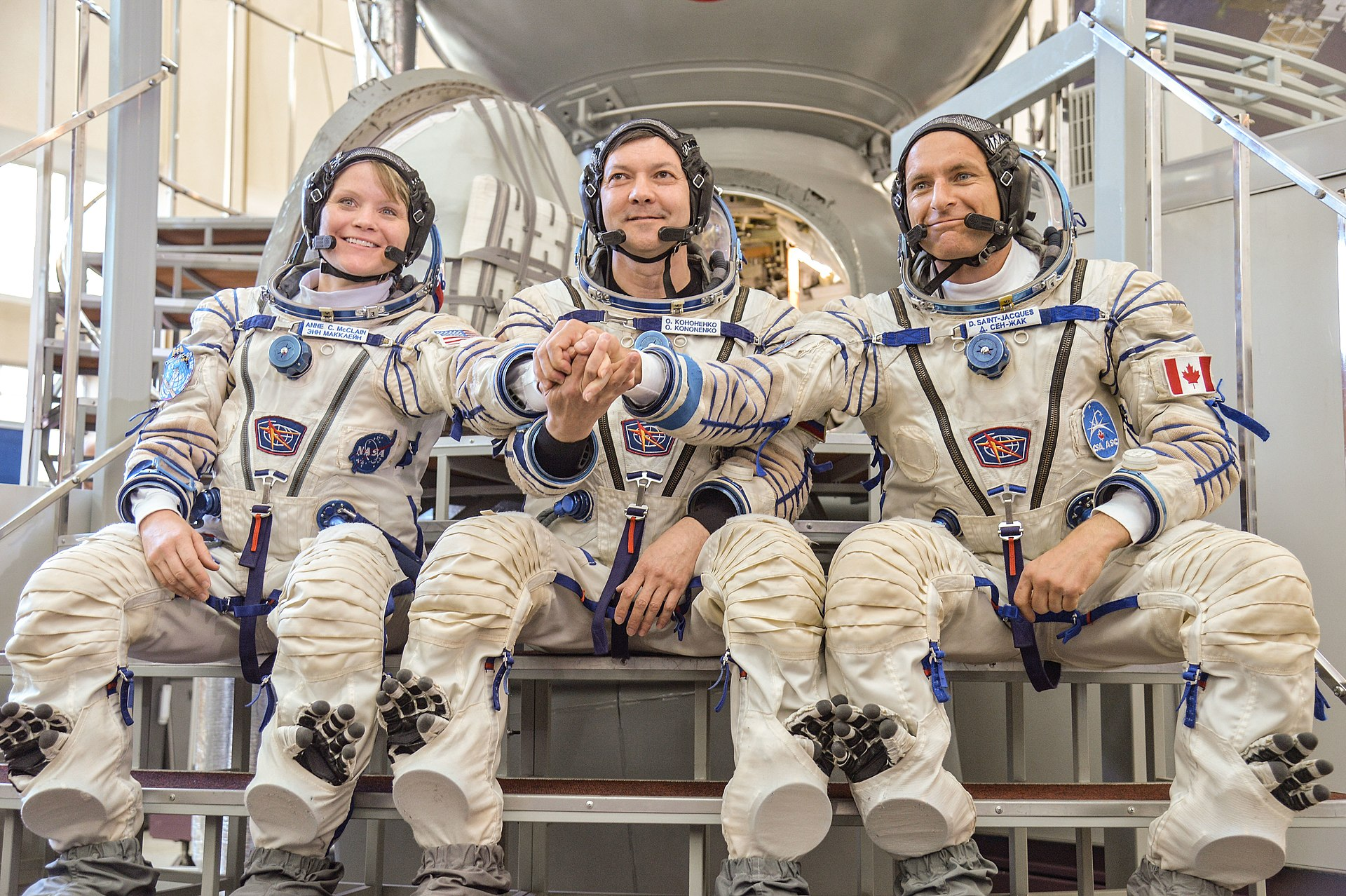NASA astronaut Anne McClain, left, Russian cosmonaut Oleg Kononenko, center, and Canadian Space Agency astronaut David Saint-Jacques post for pictures in front of a Soyuz training module after their spacecraft qualification exams. Credit: NASA/Elizabeth Weissinger