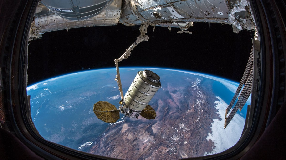 The NG-10 Cygnus is moved to the Earth-facing port of the Unity module following capture. Credit: NASA