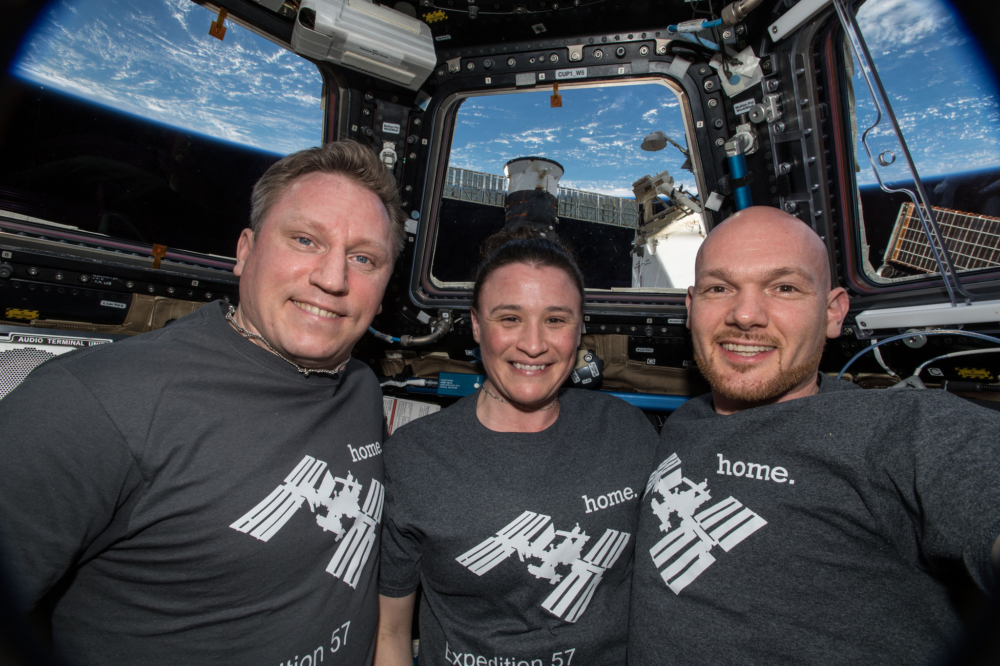 The current Expedition 57 crew -- Russian cosmonaut Sergey Prokopyev, left, NASA astronaut Serena Aunon-Chancellor, center, and European Space Agency astronaut Alexander Gerst, take a group photo in the cupola window aboard the International Space Station. Credit: NASA
