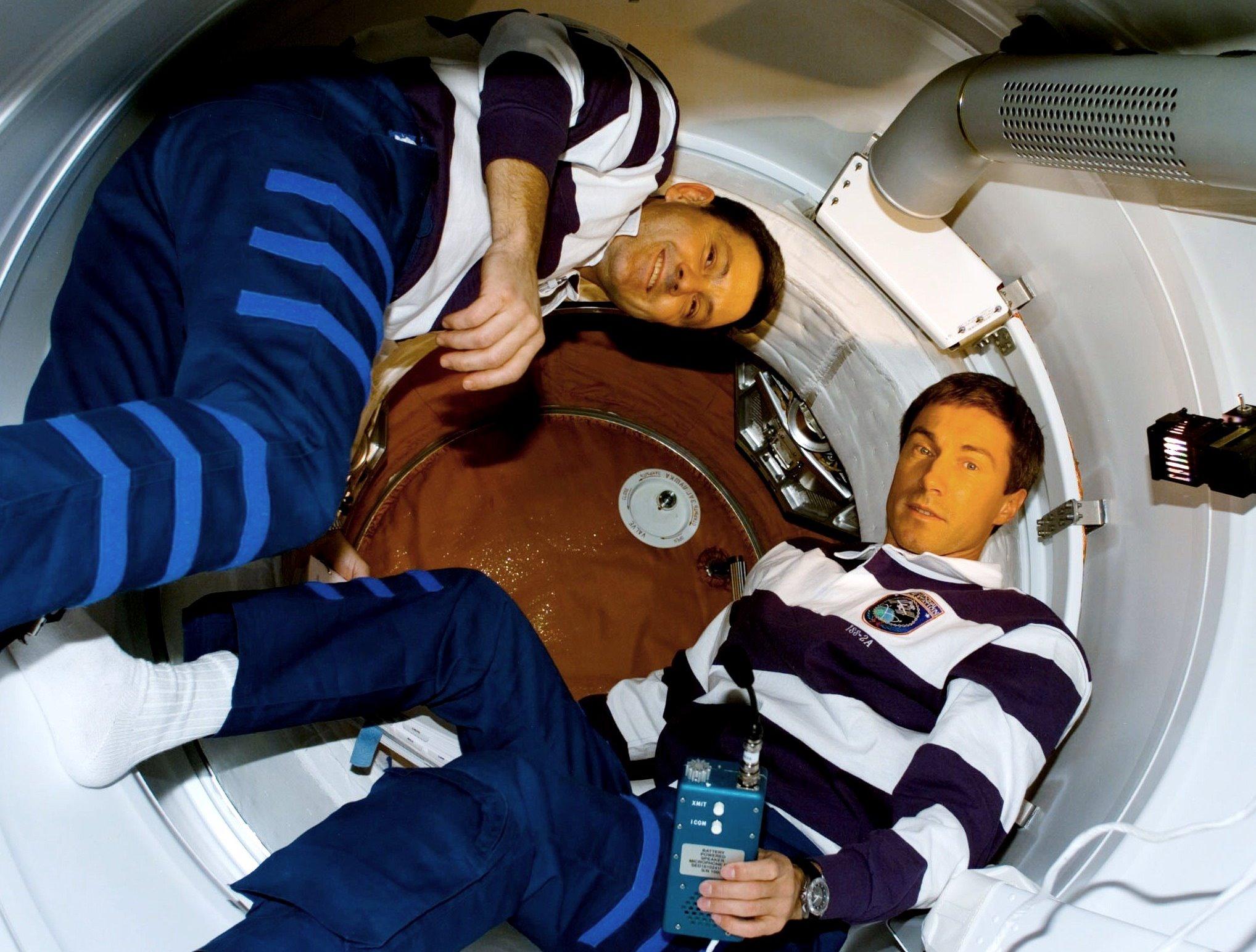 NASA astronaut Bob Cabana, left and Russian cosmonaut Sergei Krikalev prepare to open the hatch to the Zarya module during STS-88. Credit: NASA