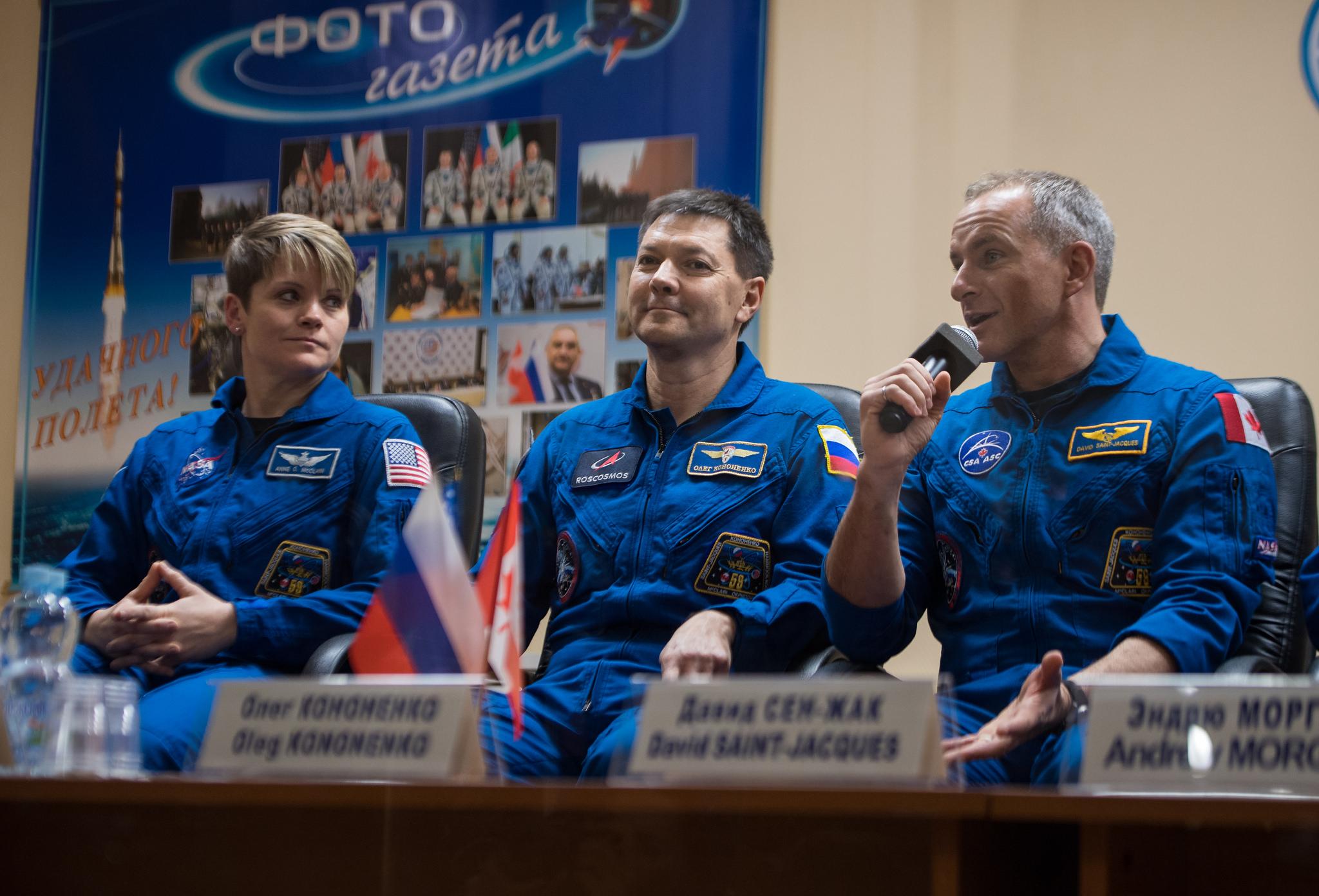 NASA astronaut Anne McClain, left, Russian cosmonaut Oleg Kononenko, center, and Canadian Space Agency astronaut David Saint-Jacques answer questions during a pre-launch press conference. Credit: NASA/Aubrey Gemignani
