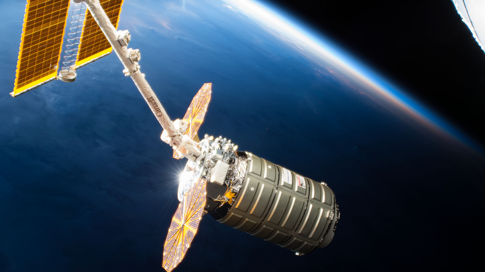 The NG-10 Cygnus spacecraft is captured by the space station's robotic arm. Credit: NASA