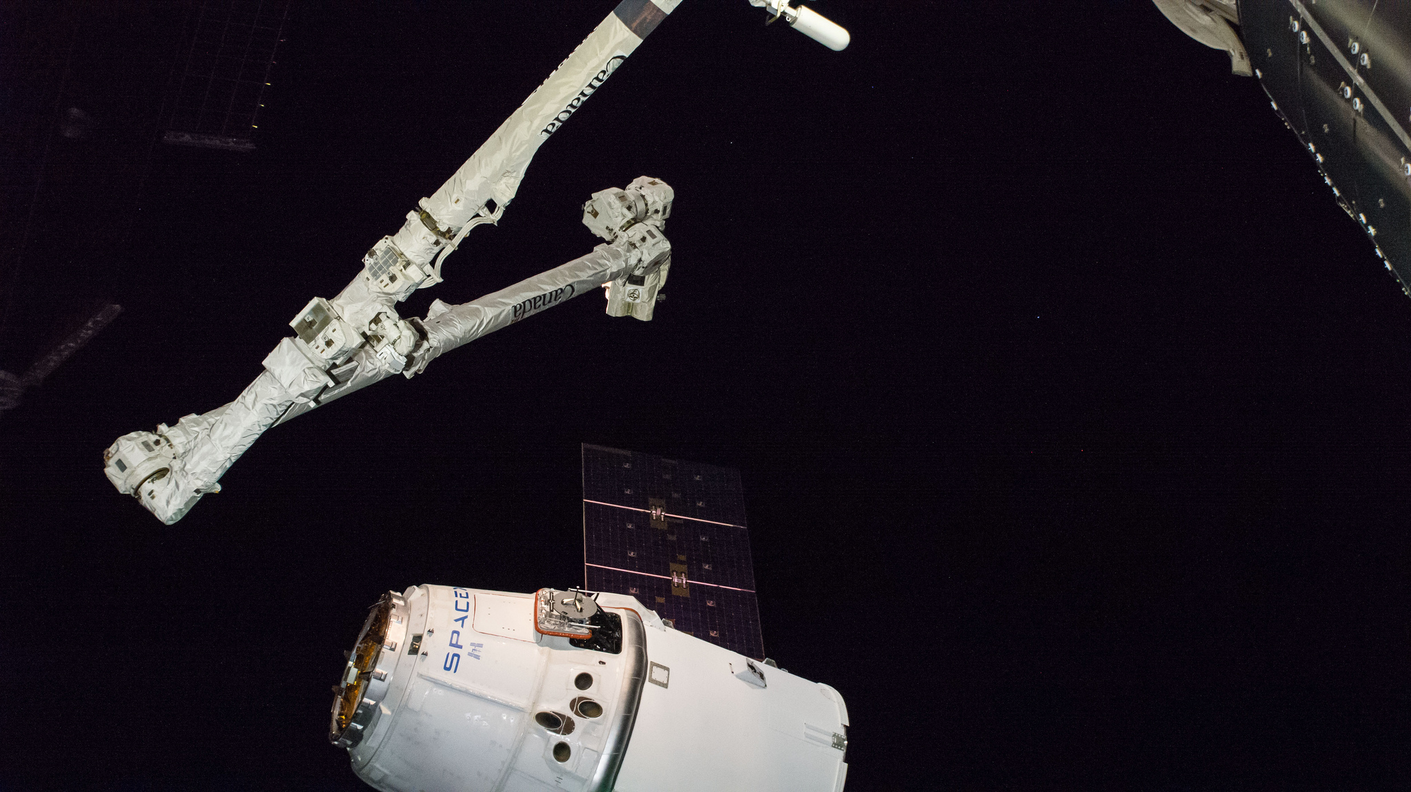 The CRS-16 Dragon moments before being captured by the space station's robotic arm. Credit: NASA