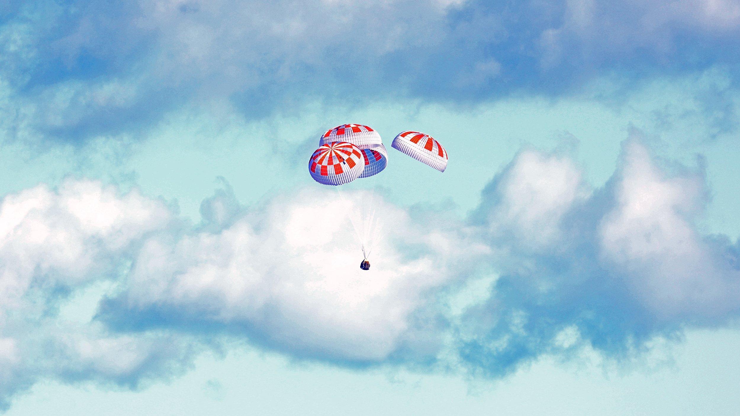 Crew Dragon descends under four parachutes before splashing down in the Atlantic Ocean. Credit: NASA