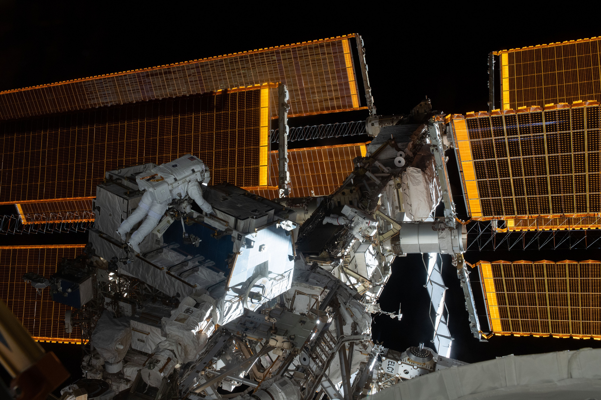 NASA astronauts Nick Hague, left, and Anne McClain work to replace batteries on the P4 truss. Credit: NASA