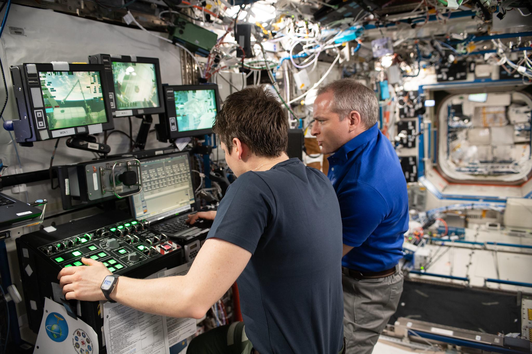 NASA astronaut Anne McClain and Canadian Space Agency astronaut David Saint-Jacques practice robotics maneuvers several days before the actual NG-11 Cygnus capture event. Credit: NASA