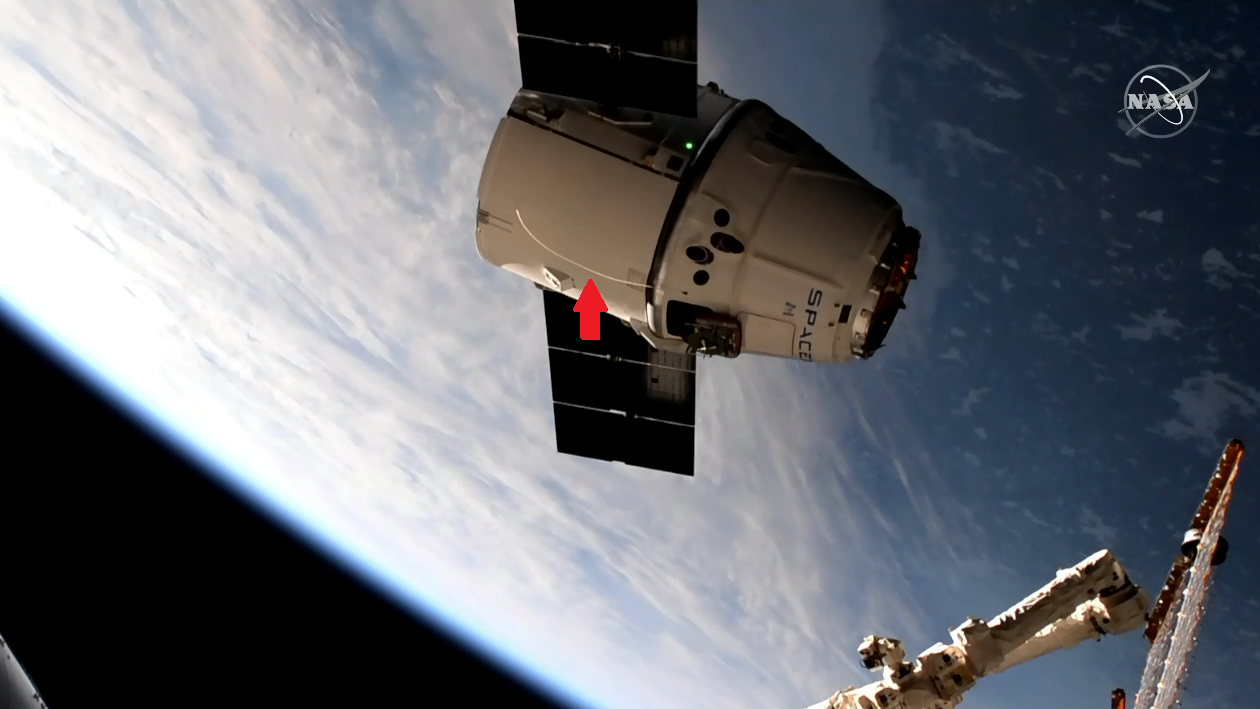 SpaceX's CRS-17 Dragon capsule moments before being captured by the International Space Station's robotic arm. It appears a cable failed to separate properly during launch and remained attached to the spacecraft. Credit: NASA
