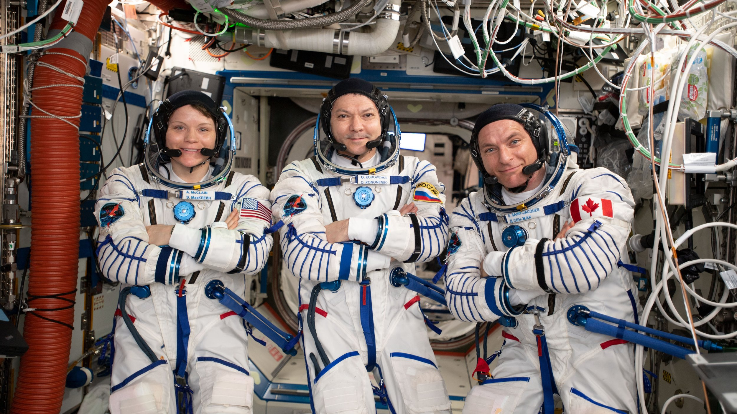 NASA's Anne McClain, left, Russia's Oleg Kononenko, center, and Canadian Space Agency astronaut David Saint-Jacques in their Sokol launch and entry suits aboard the ISS several days before their departure in Soyuz MS-11. Credit: NASA